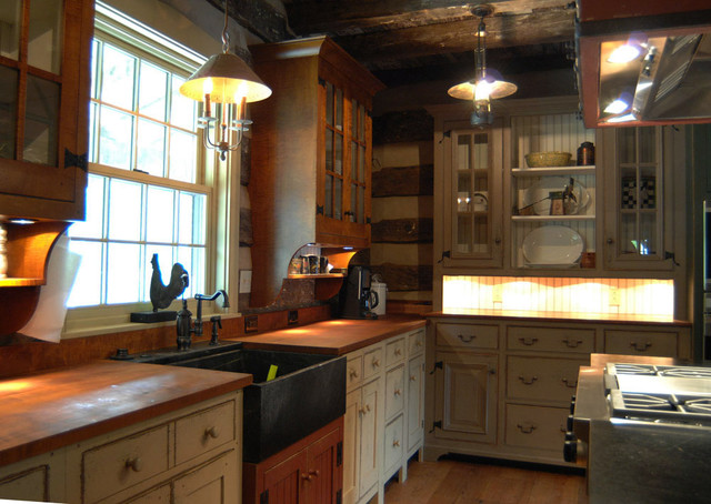 Kitchen Cabinets With Primitive Decor On Tops