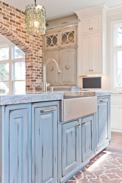 Large coastal u-shaped dark wood floor eat-in kitchen photo in Jacksonville with a farmhouse sink, beaded inset cabinets, white cabinets, marble countertops, white backsplash, glass sheet backsplash, paneled appliances and an island