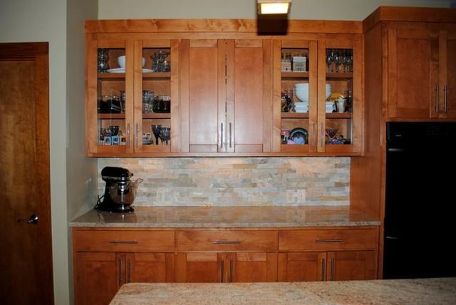 stacked stone tile backsplash and millennium cream granite kitchen