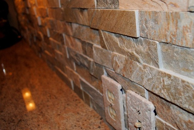 stacked stone tile backsplash and millennium cream granite