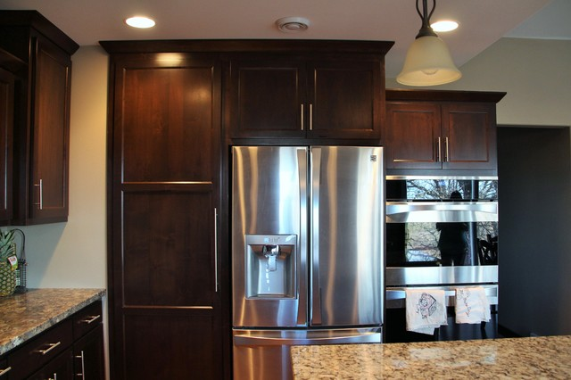 Staggered Kitchen Cabinets with Hidden Pantry