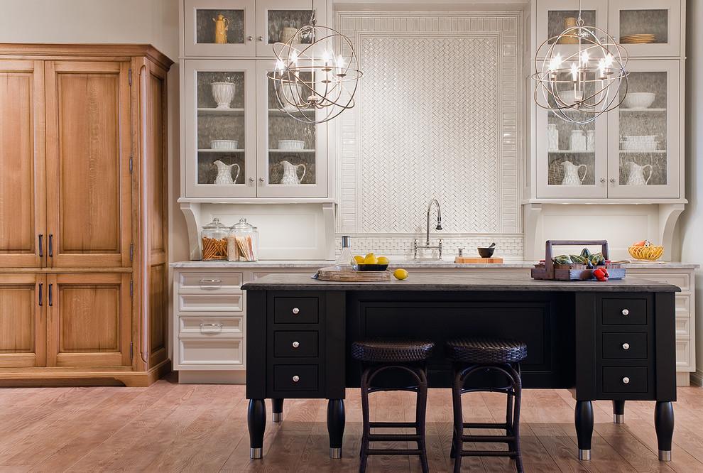 Kitchen - contemporary kitchen idea in Boston with mosaic tile backsplash, glass-front cabinets, white cabinets, granite countertops and white backsplash