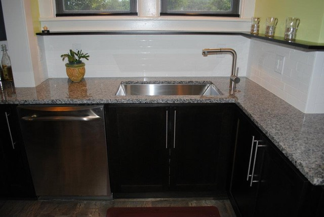 Starmark Alder Java Cabinets, Caledonia Granite Tops, Mirabelle Sink Stainlesss contemporary-kitchen