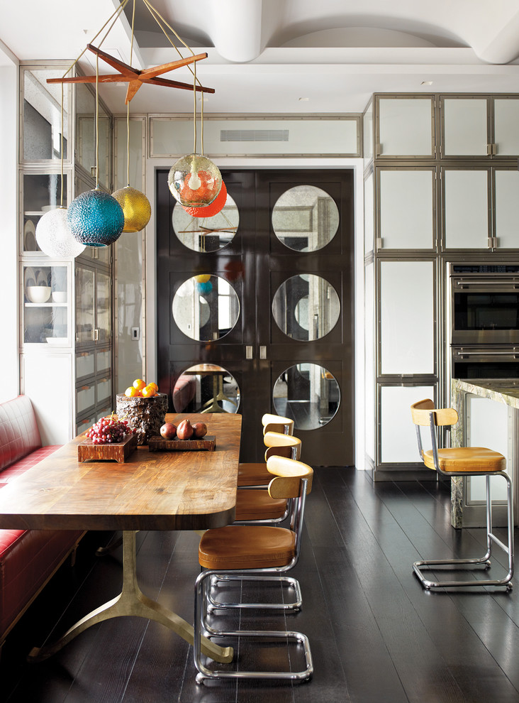 Inspiration for a contemporary eat-in kitchen remodel in New York with flat-panel cabinets, white cabinets and stainless steel appliances