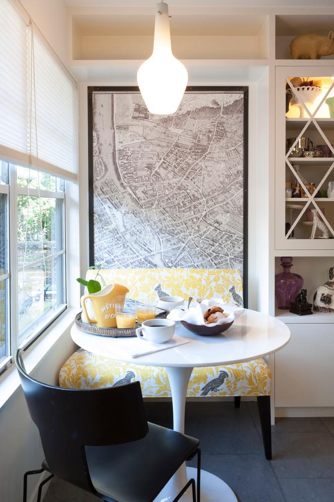 Eat-in kitchen - contemporary eat-in kitchen idea in Austin