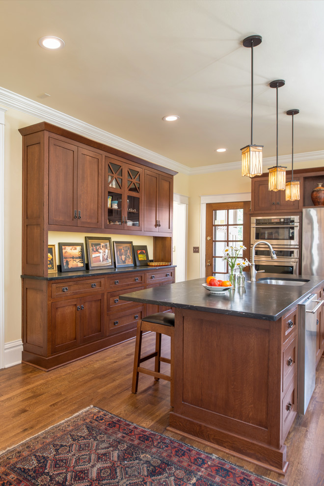 Example of an arts and crafts kitchen design in Kansas City