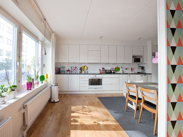 Wonderful Inspiration For A Mid Sized Scandinavian Single Wall Medium Tone Wood Floor  Eat