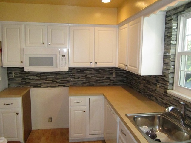 Stone And Glass Mosaic Backsplash Wrapped Window
