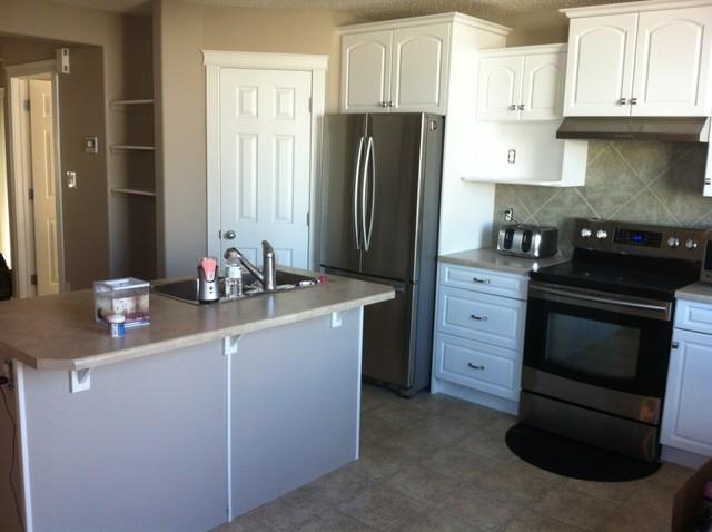 Stone Harbour Kitchen With White Cabinets Contemporary Kitchen Edmonton