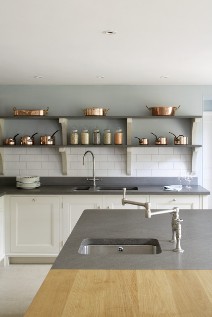 Stone shelves with copper pots