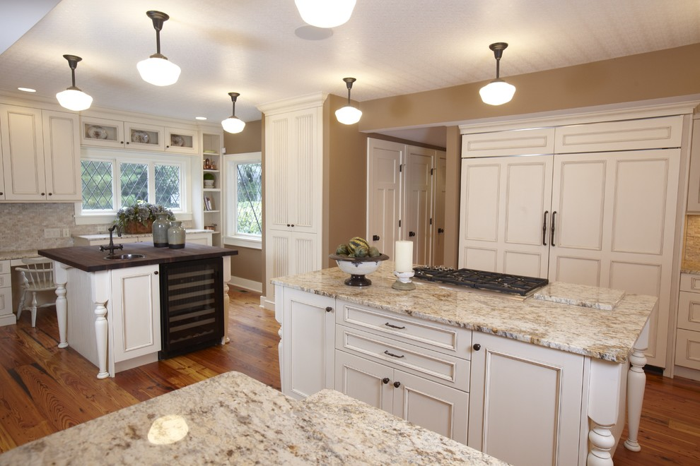 Inspiration for a timeless kitchen remodel in Tampa with recessed-panel cabinets, white cabinets, beige backsplash and paneled appliances