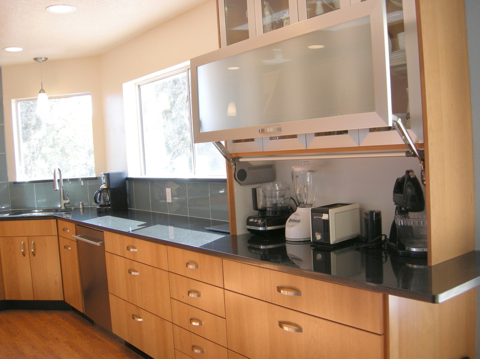 Example of a large transitional l-shaped dark wood floor eat-in kitchen design in Albuquerque with an undermount sink, flat-panel cabinets, medium tone wood cabinets, quartz countertops, green backsplash, glass tile backsplash, stainless steel appliances and no island