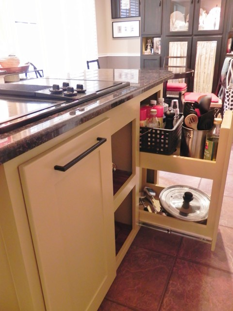 stove top storage- wide pull-out drawer holds most needed items at arms reach traditional kitchen