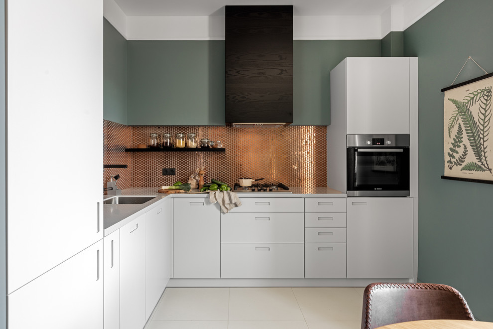 Kitchen - contemporary l-shaped kitchen idea in Other with a single-bowl sink, flat-panel cabinets, white cabinets, metallic backsplash, black appliances and no island