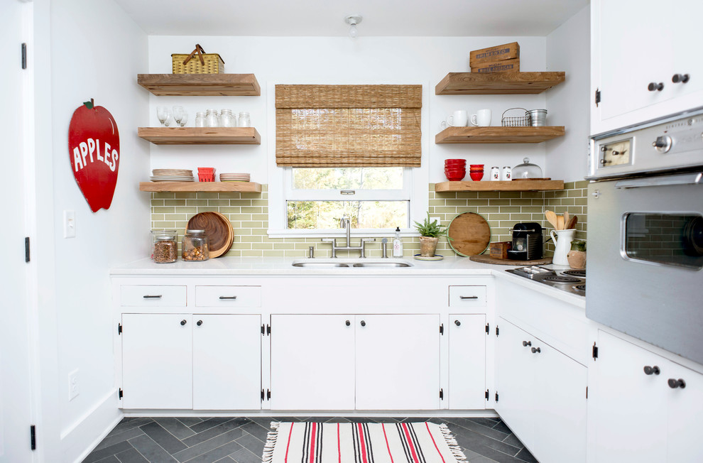 Kitchen - small cottage l-shaped kitchen idea in Raleigh with a double-bowl sink, green backsplash, no island and white cabinets