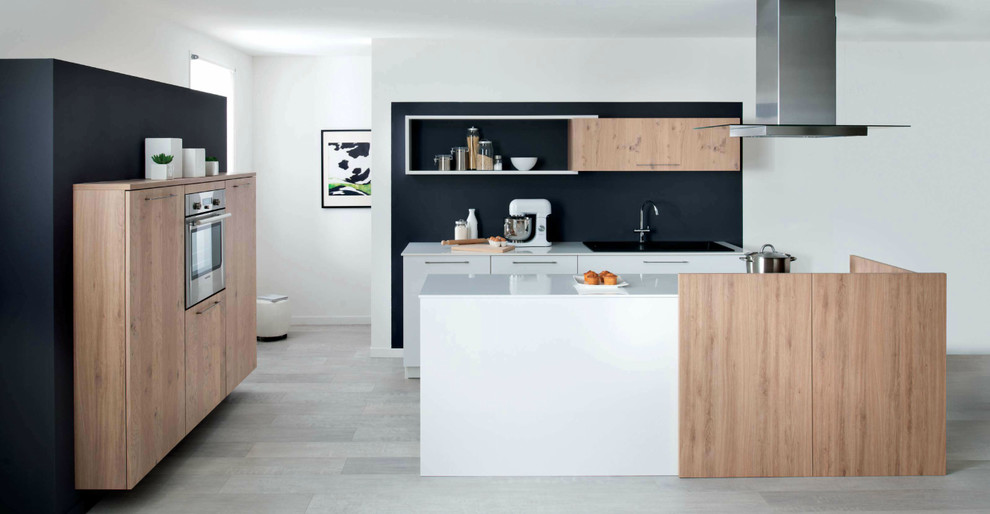 Design ideas for a small modern u-shaped open plan kitchen in London with flat-panel cabinets, light wood cabinets, quartz worktops, integrated appliances, ceramic flooring and an island.