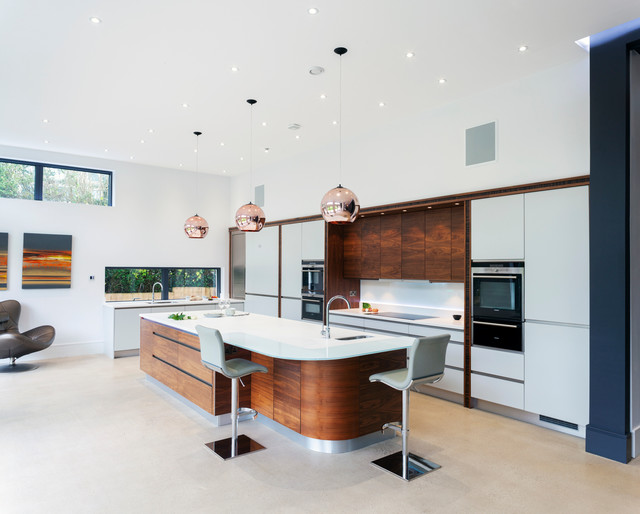 Stoneham Kitchens stylish copper kitchen featuring accent lighting contemporary
