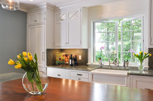 Kitchen with mirror cabinet doors.