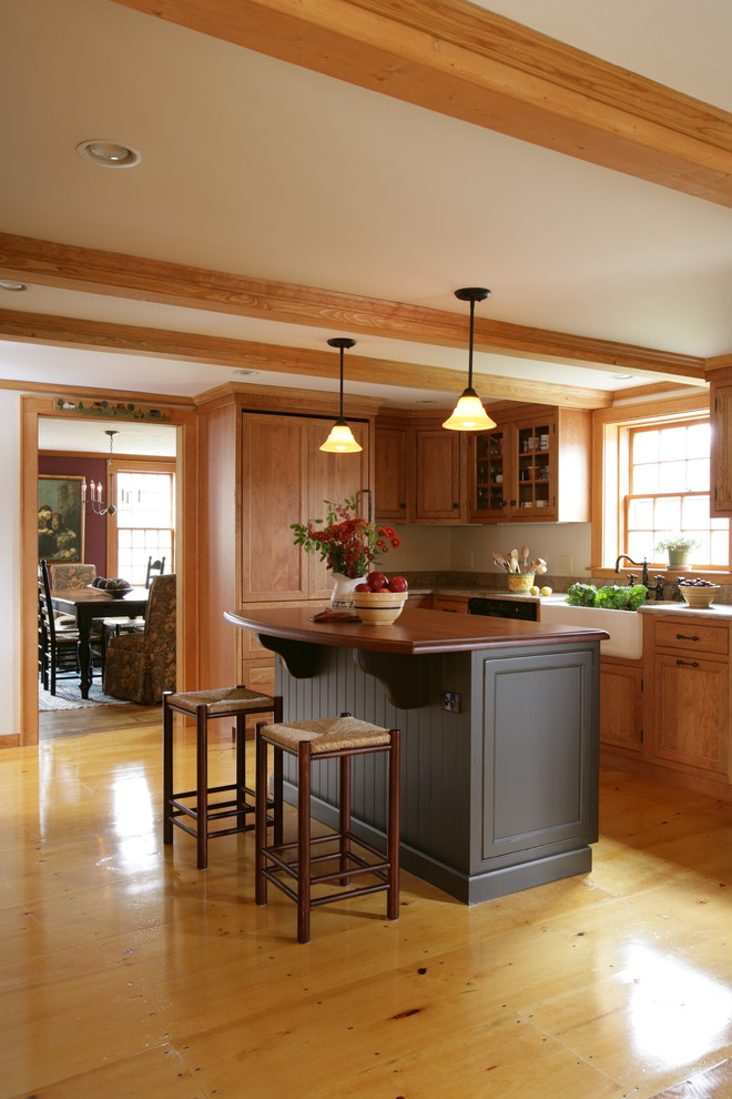 Mid-sized arts and crafts light wood floor and beige floor enclosed kitchen photo in Boston with a farmhouse sink, wood countertops, light wood cabinets, paneled appliances, an island and brown countertops