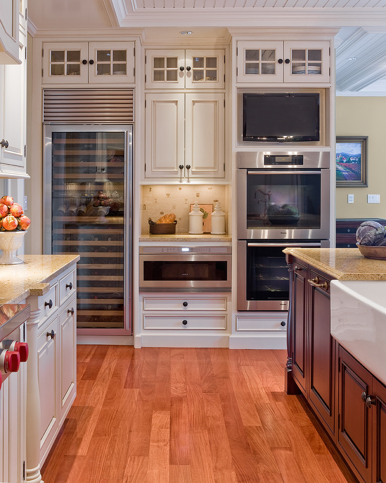 Inspiration for a timeless kitchen remodel in Boston with beaded inset cabinets, stainless steel appliances, a farmhouse sink and white cabinets