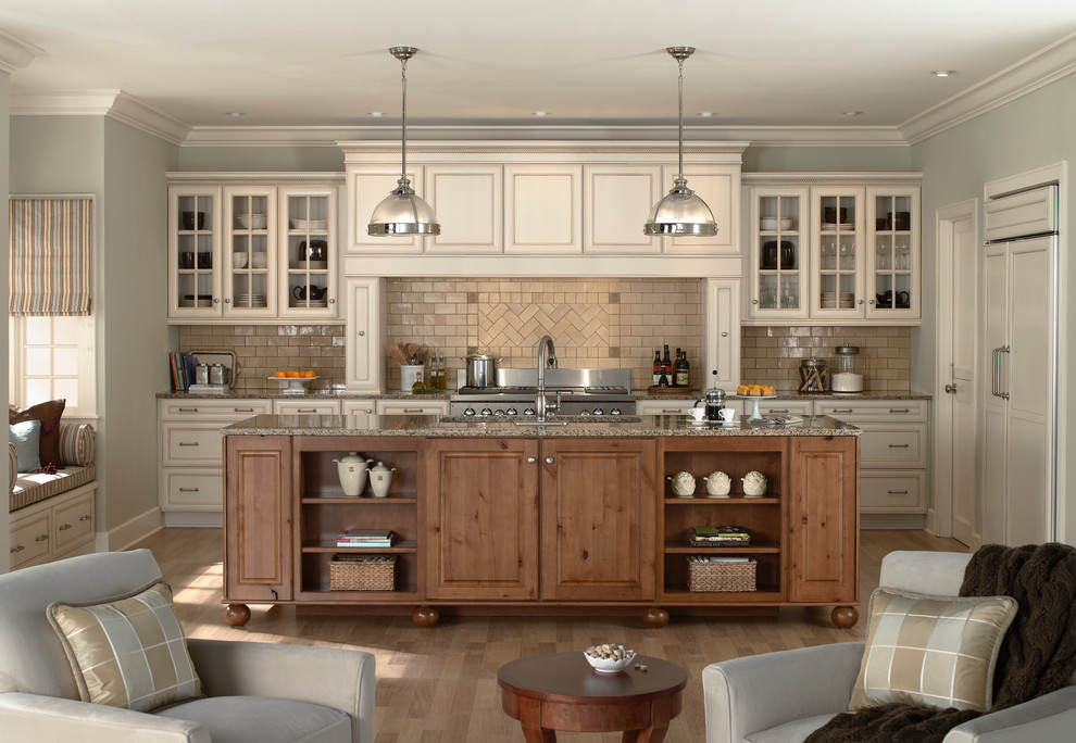 Example of a mid-sized transitional galley medium tone wood floor eat-in kitchen design in Minneapolis with glass-front cabinets, beige cabinets, beige backsplash, subway tile backsplash, paneled appliances, granite countertops and an island