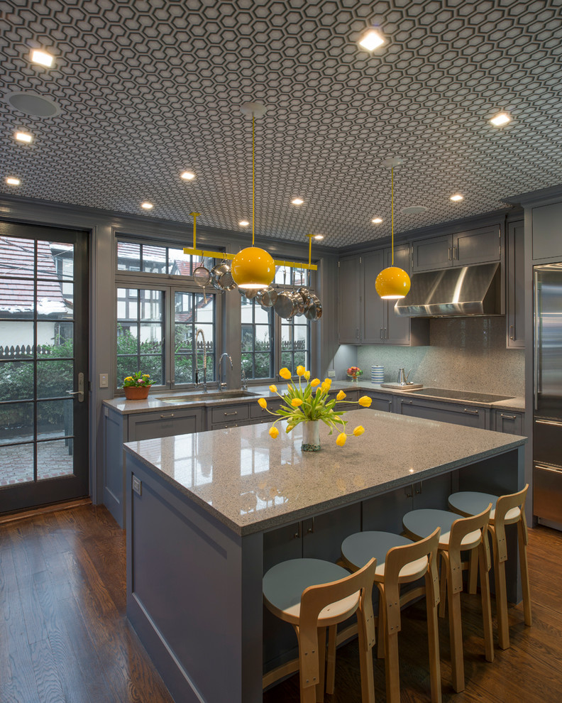 Example of a large trendy u-shaped medium tone wood floor kitchen design in New York with recessed-panel cabinets, quartz countertops, an island, an undermount sink and green cabinets