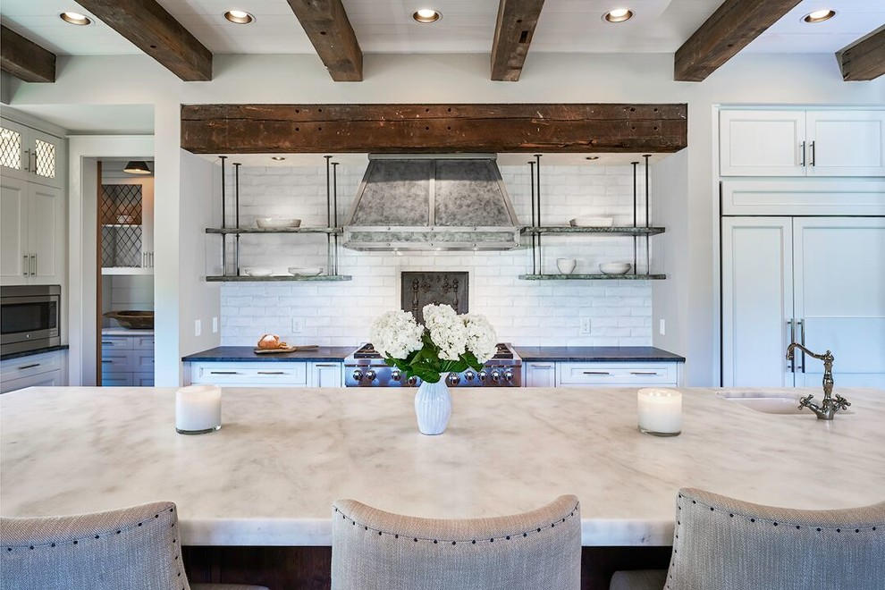 Inspiration for a farmhouse kitchen remodel in Atlanta with an undermount sink, recessed-panel cabinets, blue cabinets, marble countertops, white backsplash, stainless steel appliances and an island
