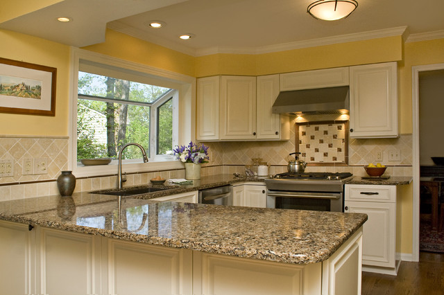 Sunny Tuscan Inspired Kitchen with Beautiful Bronze ...