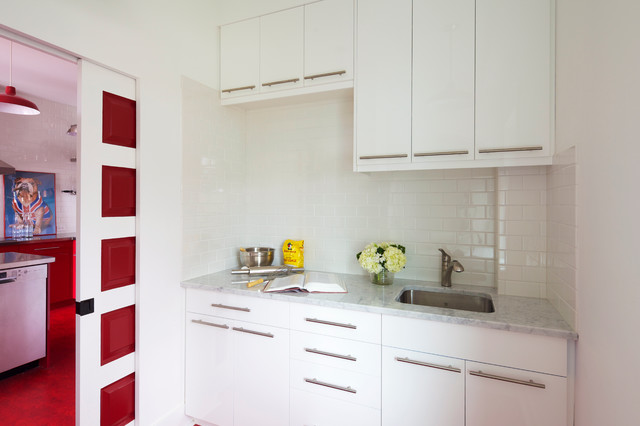 Small contemporary single-wall kitchen pantry in Calgary with a submerged sink, flat-panel cabinets, white cabinets, marble worktops, white splashback, metro tiled splashback and no island.