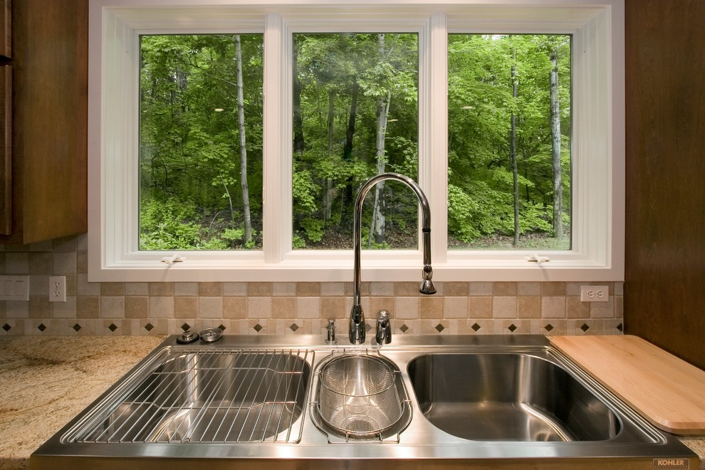 Inspiration for a transitional kitchen remodel in Other with a double-bowl sink, medium tone wood cabinets and stainless steel appliances