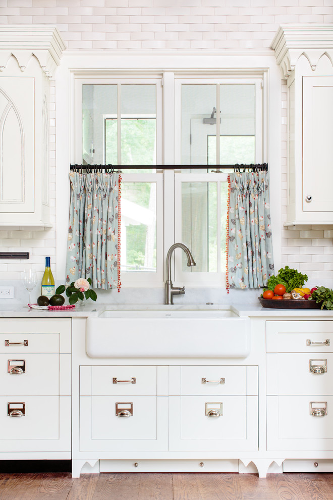 Inspiration for a timeless kitchen remodel in Other with a farmhouse sink, recessed-panel cabinets, white cabinets and beige backsplash