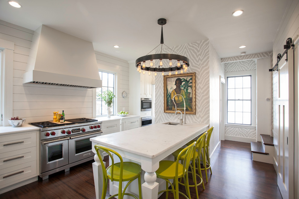 Example of a transitional l-shaped kitchen design in Boston with shaker cabinets, white cabinets and stainless steel appliances