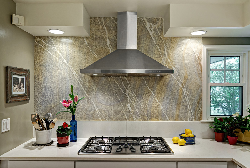 Example of a mid-sized transitional eat-in kitchen design in Minneapolis with shaker cabinets, white cabinets, quartz countertops, yellow backsplash, stone slab backsplash, stainless steel appliances and a peninsula