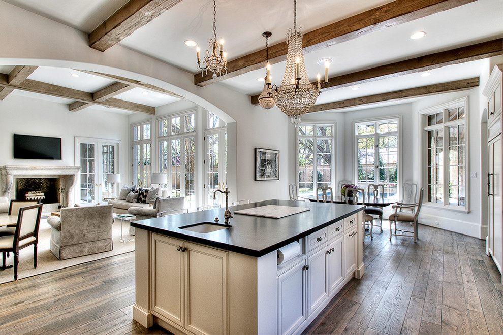 Open concept kitchen - traditional open concept kitchen idea in Houston with a single-bowl sink, recessed-panel cabinets, beige cabinets and black countertops
