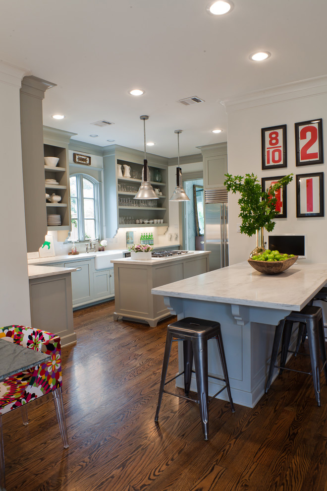 Kitchen - transitional kitchen idea in Houston with a farmhouse sink, stainless steel appliances, open cabinets and gray cabinets