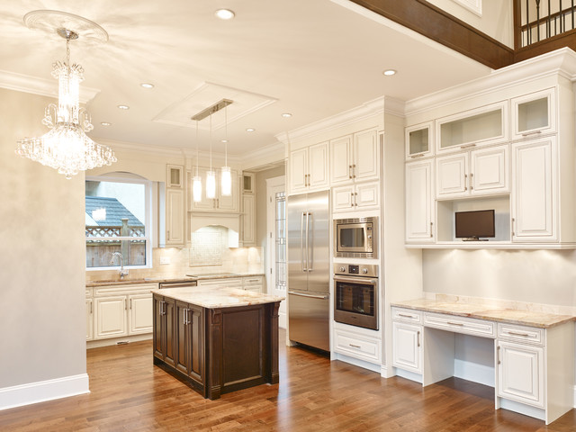 Example of a transitional l-shaped medium tone wood floor eat-in kitchen design in Vancouver with an undermount sink, raised-panel cabinets, light wood cabinets, granite countertops, beige backsplash, stone tile backsplash, stainless steel appliances and an island