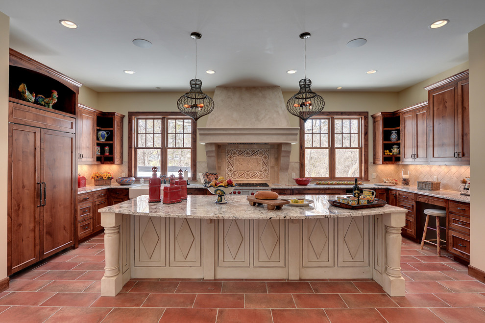 Kitchen - rustic u-shaped kitchen idea in Minneapolis with a farmhouse sink, recessed-panel cabinets, medium tone wood cabinets, beige backsplash and paneled appliances