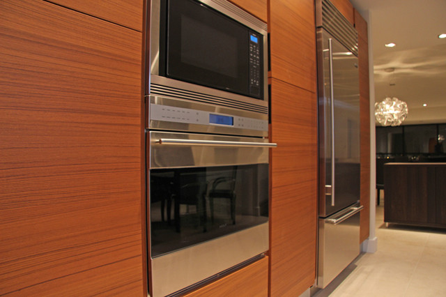 Teak wood kitchen cabinetry for Modern teak kitchen cabinets