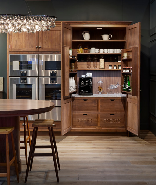 Inspiration for a timeless light wood floor kitchen remodel in Oxfordshire with shaker cabinets, dark wood cabinets and stainless steel appliances