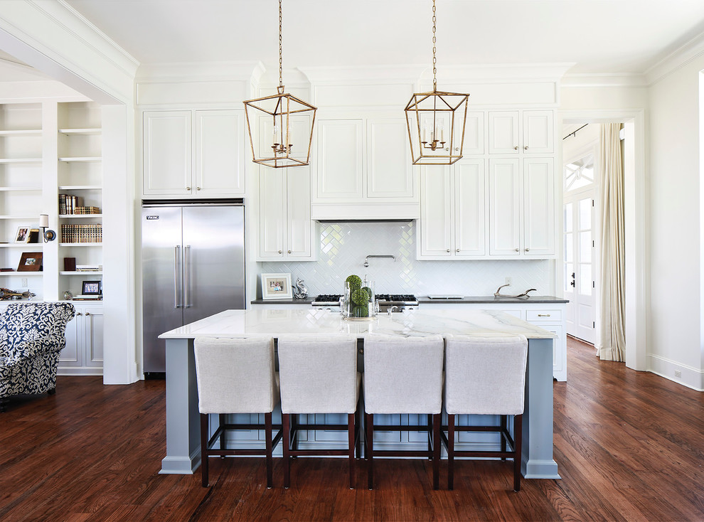 Inspiration for a timeless open concept kitchen remodel in Nashville with recessed-panel cabinets, white cabinets, white backsplash, subway tile backsplash and stainless steel appliances
