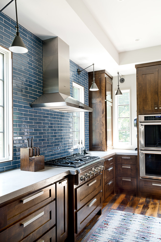 Kitchen - large transitional u-shaped dark wood floor kitchen idea in Other with an undermount sink, shaker cabinets, dark wood cabinets, concrete countertops, blue backsplash, subway tile backsplash, stainless steel appliances and an island