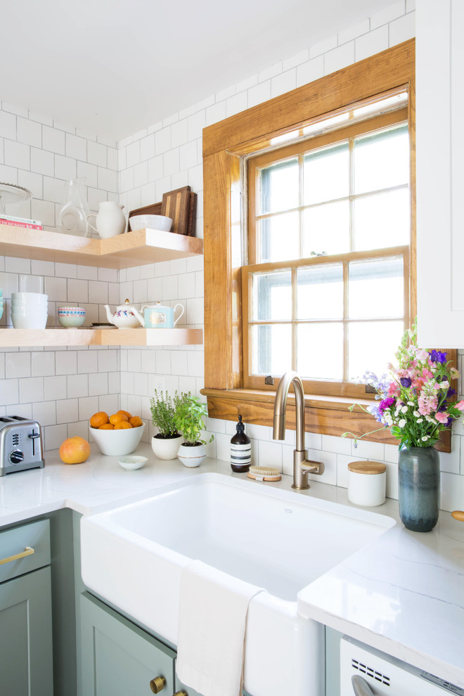 Eat-in kitchen - small transitional u-shaped medium tone wood floor and brown floor eat-in kitchen idea in Other with a farmhouse sink, shaker cabinets, blue cabinets, quartz countertops, white backsplash, porcelain backsplash, white appliances and a peninsula