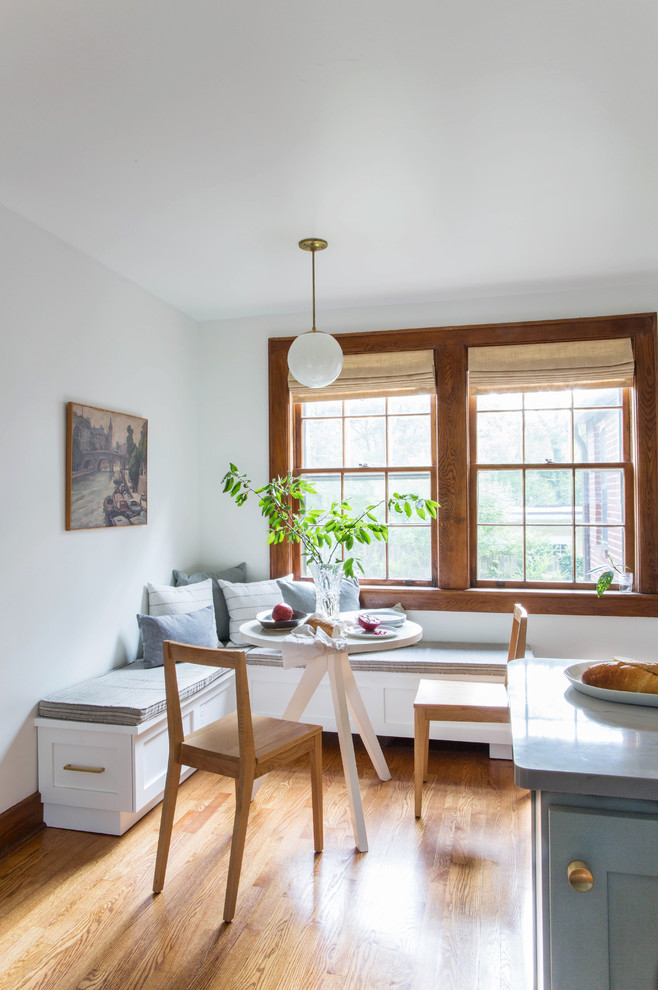 Inspiration for a small transitional l-shaped medium tone wood floor and beige floor eat-in kitchen remodel in Other with a farmhouse sink, recessed-panel cabinets, gray cabinets, quartz countertops, white backsplash, subway tile backsplash, white appliances and a peninsula