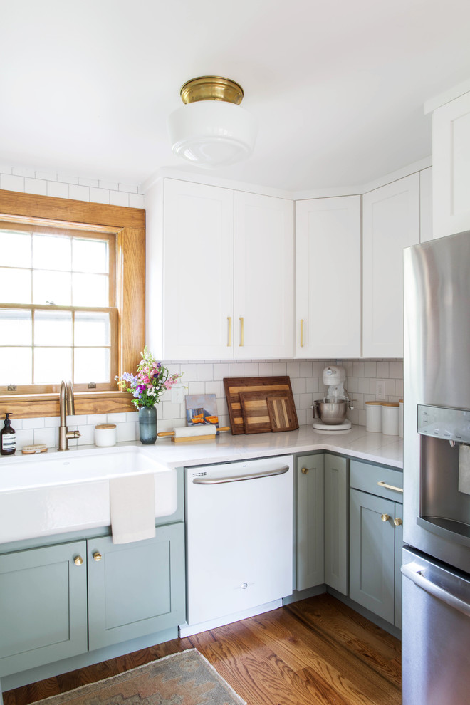 Eat-in kitchen - small transitional l-shaped dark wood floor and brown floor eat-in kitchen idea in Other with a farmhouse sink, recessed-panel cabinets, gray cabinets, white backsplash, subway tile backsplash, white appliances and quartz countertops