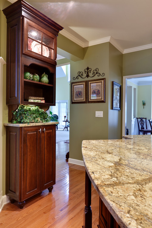 Love the green paint with the cherry cabinets will you for Cherry kitchen cabinets wall color