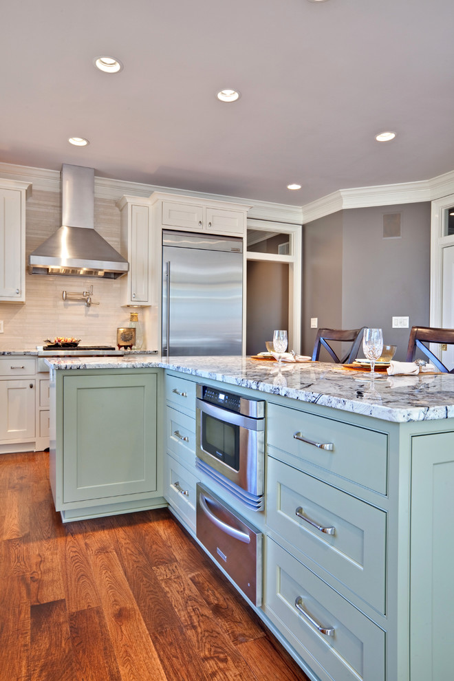 Inspiration for a contemporary kitchen remodel in Atlanta with stainless steel appliances, granite countertops, beaded inset cabinets, green cabinets and beige backsplash