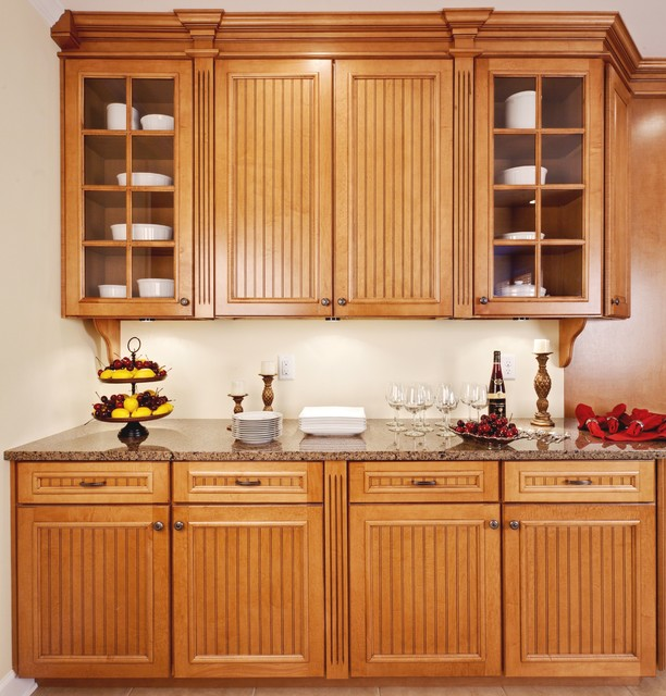 Kitchen - traditional kitchen idea in Atlanta with glass-front cabinets, medium tone wood cabinets and granite countertops