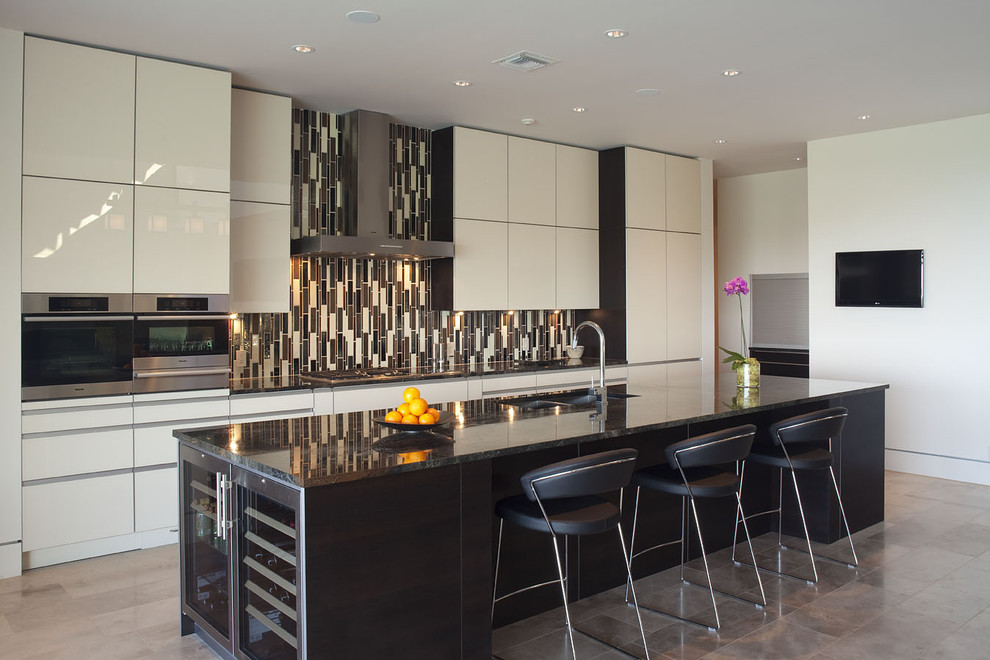 Eat-in kitchen - large contemporary galley porcelain tile eat-in kitchen idea in Austin with flat-panel cabinets, white cabinets, multicolored backsplash, matchstick tile backsplash, a double-bowl sink, granite countertops, stainless steel appliances and an island