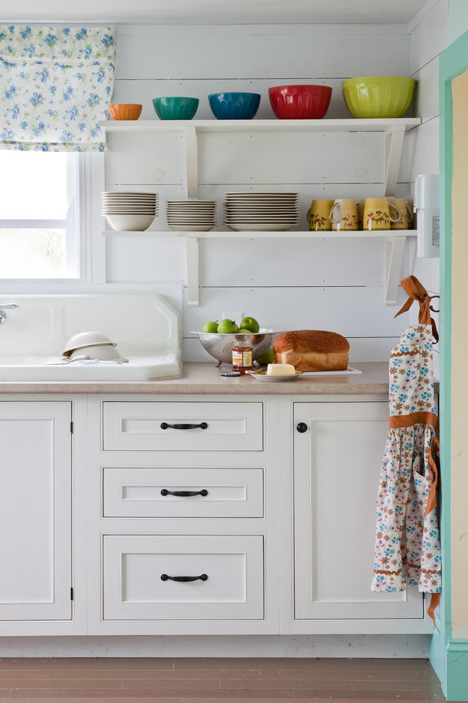 Example of a beach style kitchen design in Other with a drop-in sink, beaded inset cabinets and white cabinets