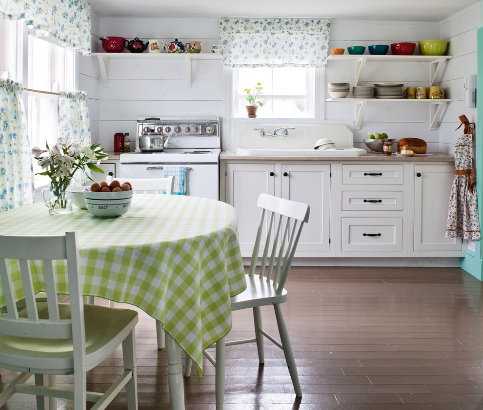 Inspiration for a shabby-chic style eat-in kitchen remodel in Other with a drop-in sink, beaded inset cabinets, white cabinets and white appliances